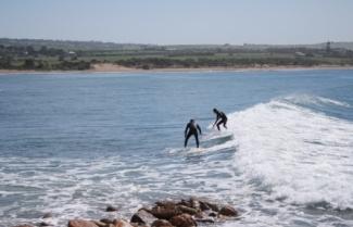 surfers at Chicken Run