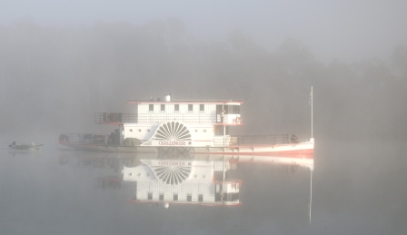 paddle wheeler in the mist